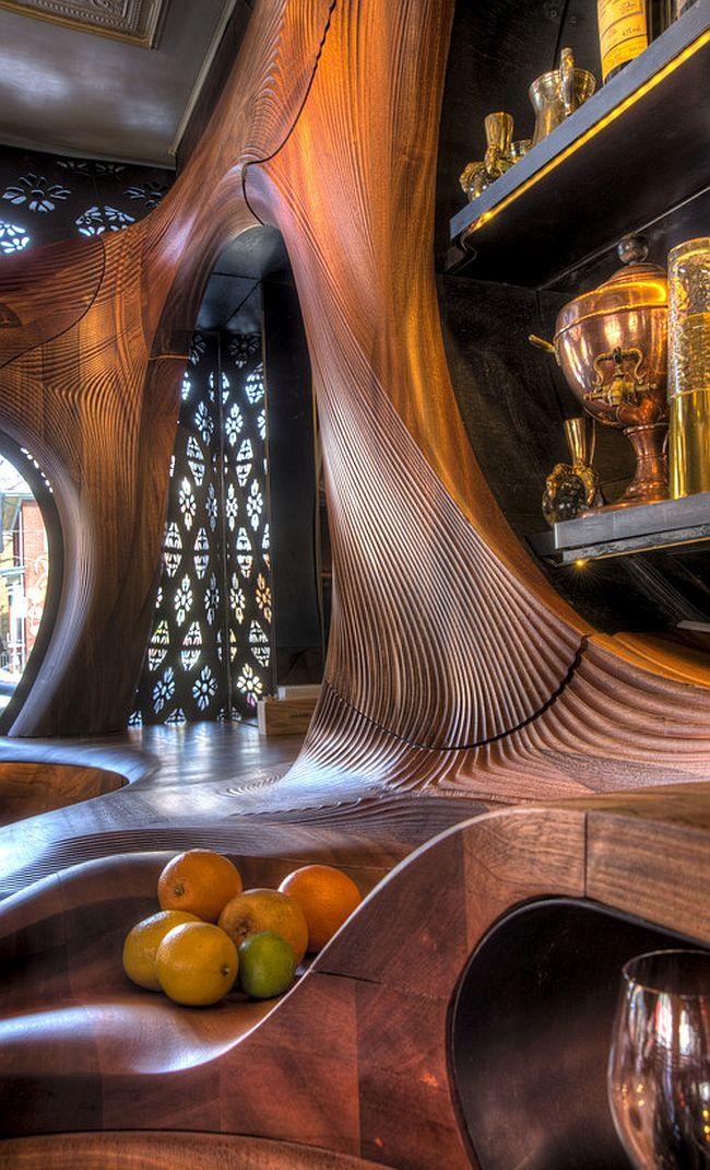https://cdn.decoist.com/wp-content/uploads/2015/04/Futuristic-design-meets-wooden-magic-inside-Bar-Raval-Toronto.jpg