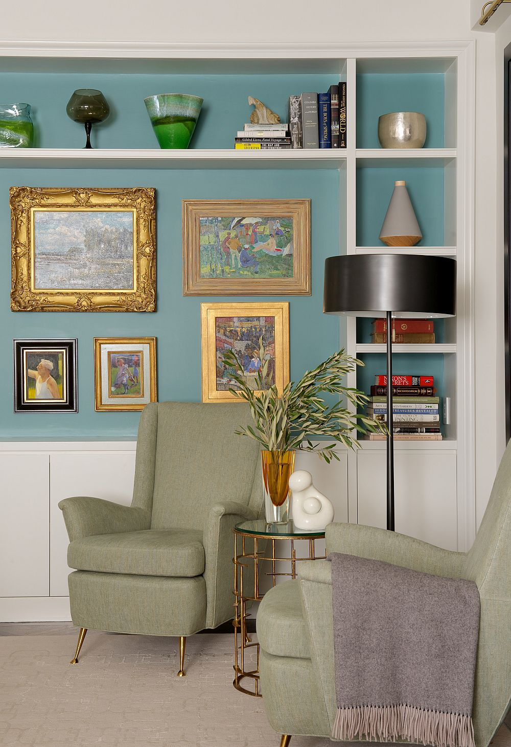 Gallery wall along with floating shelves creates a lovely display