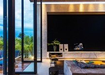 Giant glass doors connect the living area with the courtyard outside