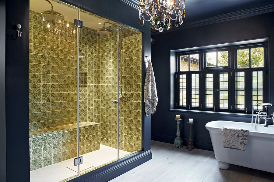 Glamorous chandelier holds its own in this elegant bathroom! [Design: Godrich Interiors]