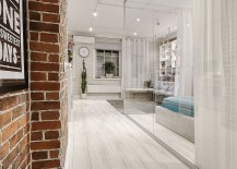 Glass-partitions-fill-the-interior-with-airy-charm-217x155