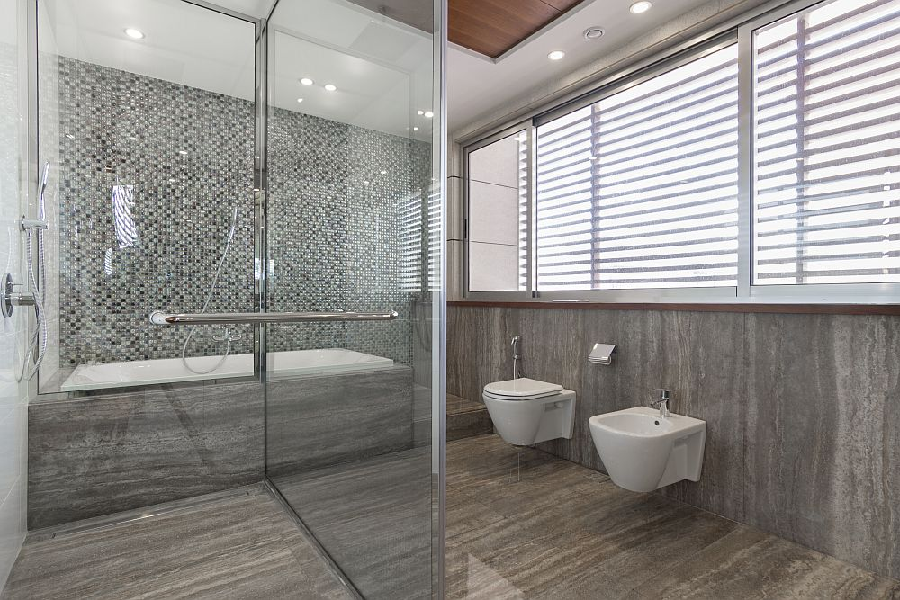 Glass shower area inside the modern bathroom