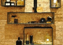 Gold wall covering adds texture to the bathroom wall