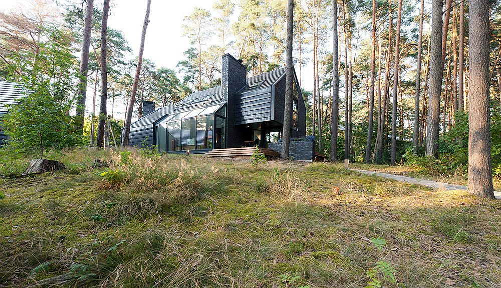 Gorgeous Black House Blues in Lithuania surrounded by forest