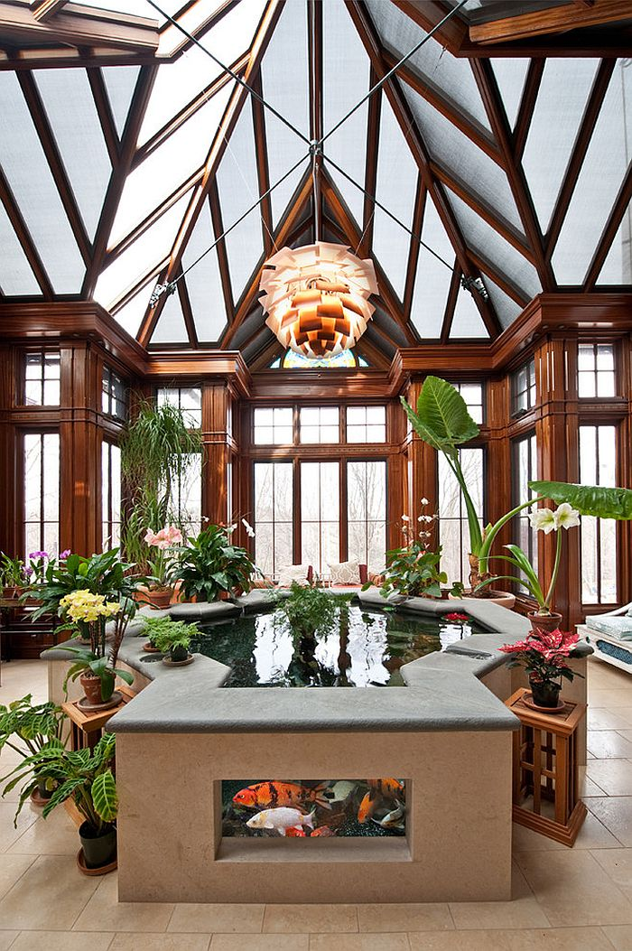 Gorgeous Koi Pond becomes the focal point of the grand sunroom [Design: Chase Building Group]