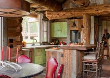 Gorgeous cabin kitchen and dining area with exposed wooden logs above