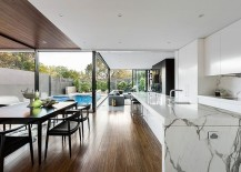 Gorgeous marble kitchen island defines the elegant open kitchen
