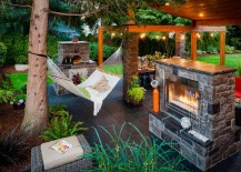 Gorgeous outdoor living area complete with fireplace and hammock