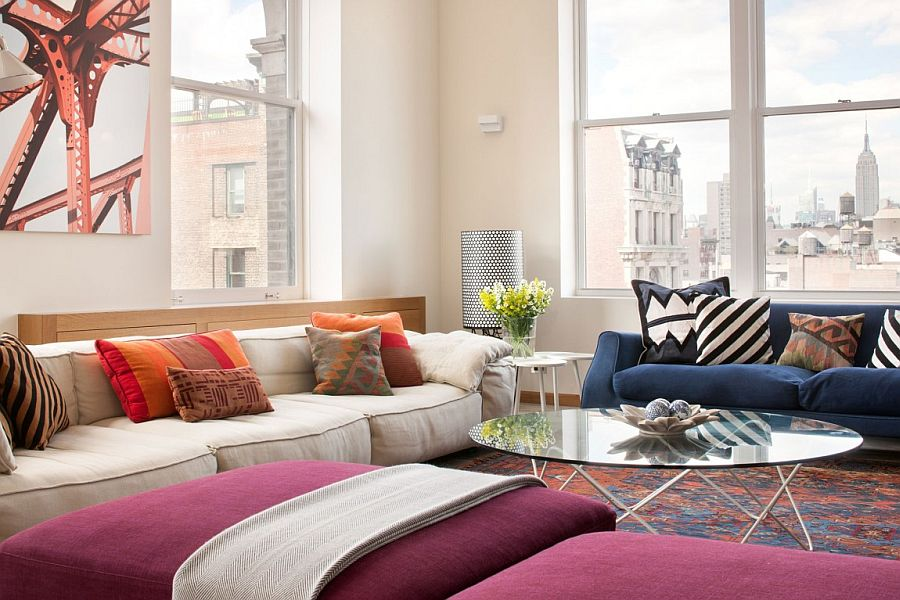 Gorgeous use of colorful couch and ottomans enlivens the chic living area