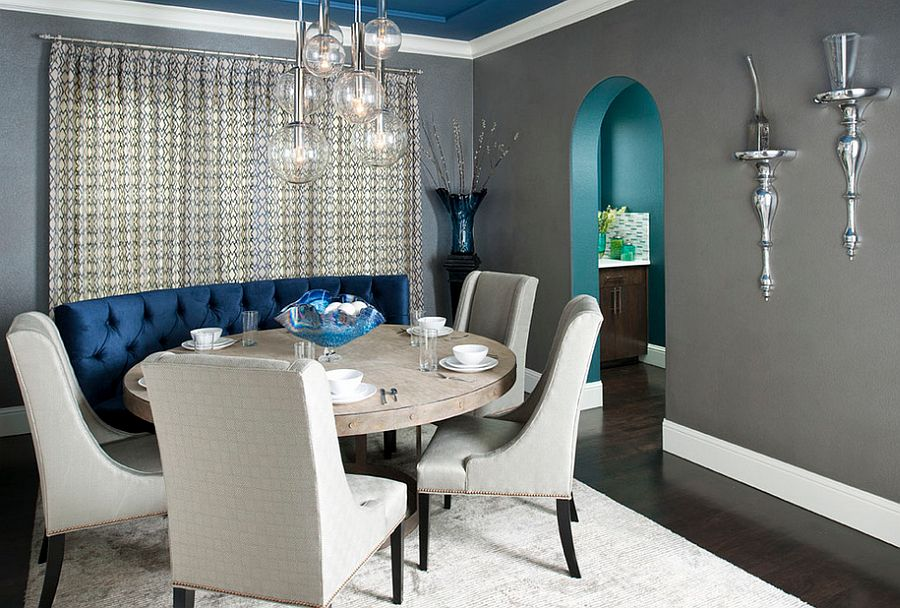 Gray dining room with custom designed blue banquet and ceiling