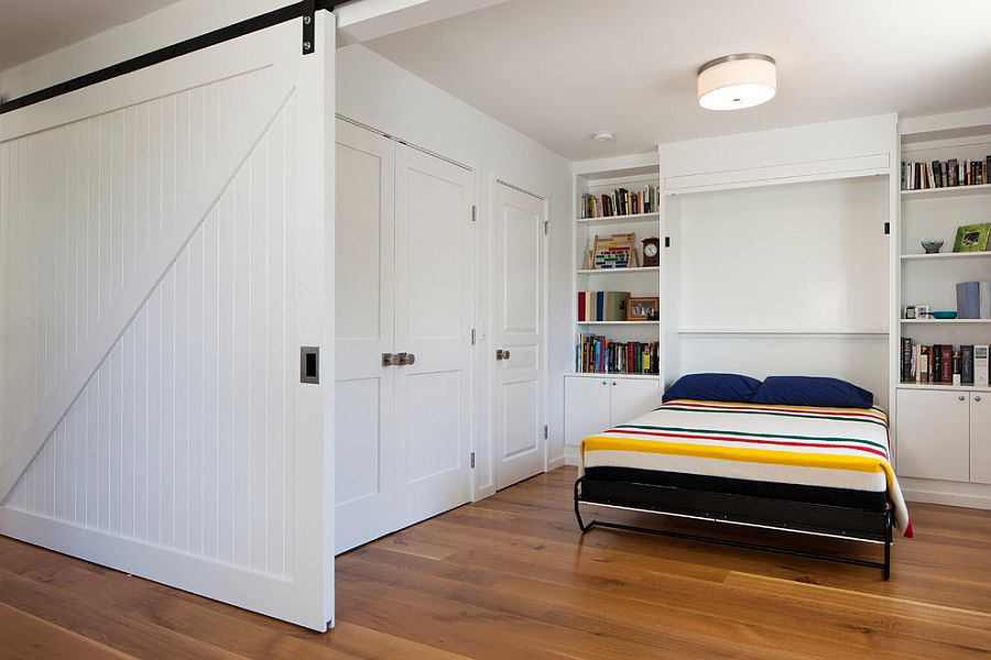 25 bedrooms that showcase the beauty of sliding barn doors. Black Bedroom Furniture Sets. Home Design Ideas