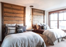 Headboards and light fixture steal the show in this bedroom