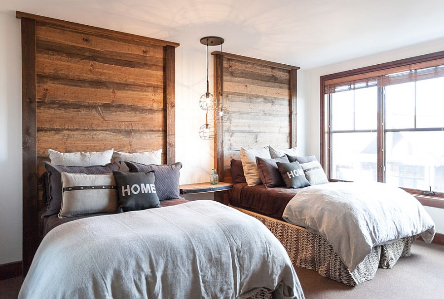 headboards and light fixture steal the show in this bedroom design
