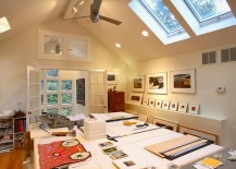 Home-office-with-extra-large-work-bench-for-artist-and-skylights-217x155
