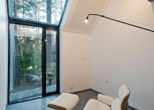 Iconic-Eames-Lounger-sits-inside-the-Black-House-Blues-overlooking-the-forest-217x155