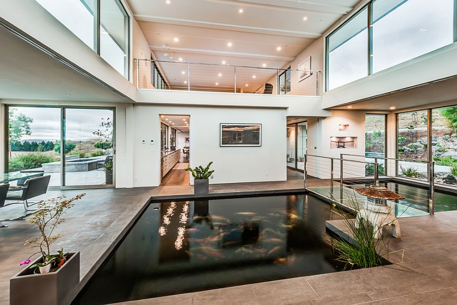 30 interiors that showcase hot design trends of summer 2015 for Indoor koi pool
