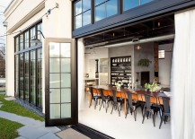 Industrial appeal of the home is accentuated by the large framed glass doors 217x155 Renovated Portland Home Brings Vintage Industrial Style with Energy Efficiency