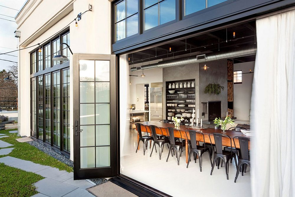 Industrial appeal of the home is accentuated by the large, framed glass doors