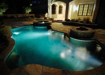 Ingenious pool with twin water features and a fire pit