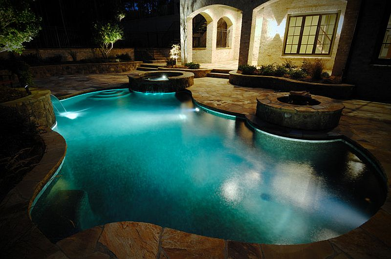 View In Gallery Ingenious Pool With Twin Water Features And A Fire Pit [ Design: Bluewater Construction Group