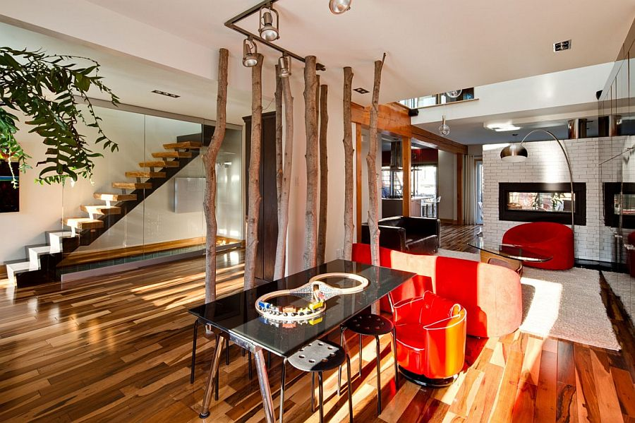 Ingenious way to create a cool partition in the open plan living area with tree trunks