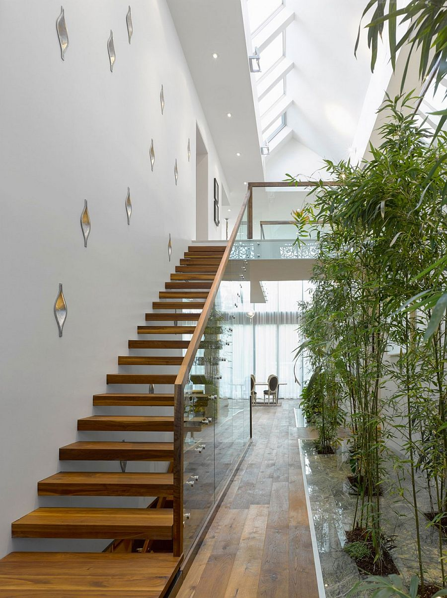 Interior bamboo garden and sculptural staircase of the brilliant Ontario home