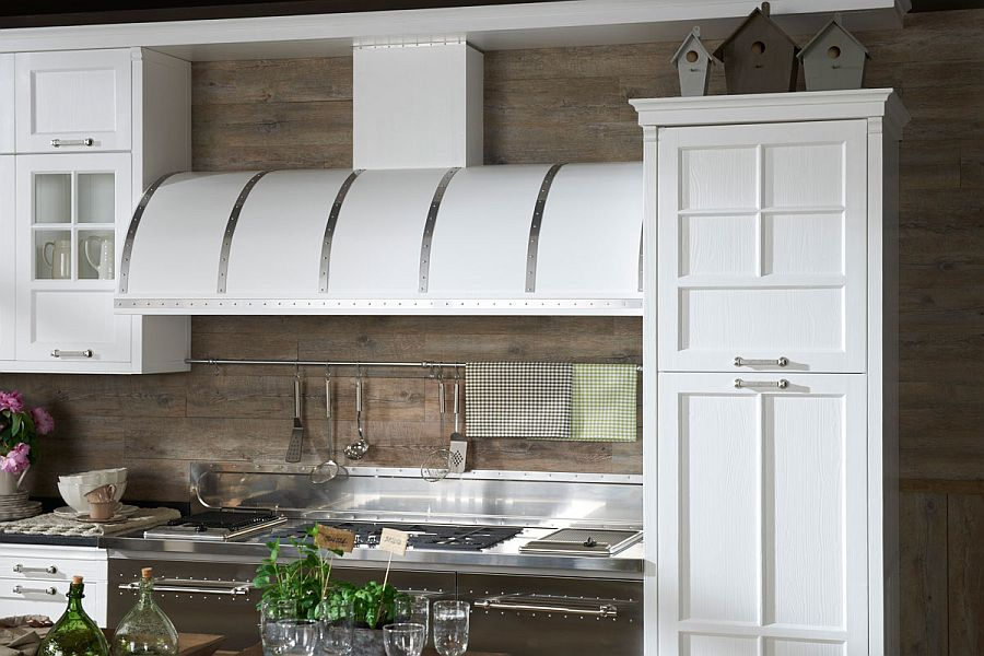 Intriguing design of the cabinets and the hood elevate the vintage appeal of the kitchen