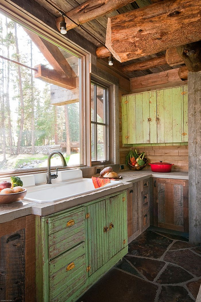 Kitchen window above teh sink overlooks the scenic landscape outside