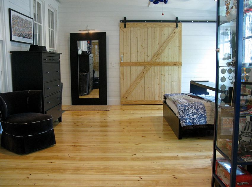Knotty pine barn door in the modern bedroom [Design: Van Wicklen Design]