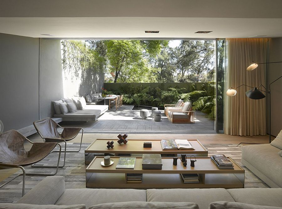 8 airy homes with giant glass walls that open to courtyards Opening glass walls
