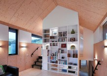 Large-bookshelf-in-white-adds-contemporary-touch-to-the-home-217x155