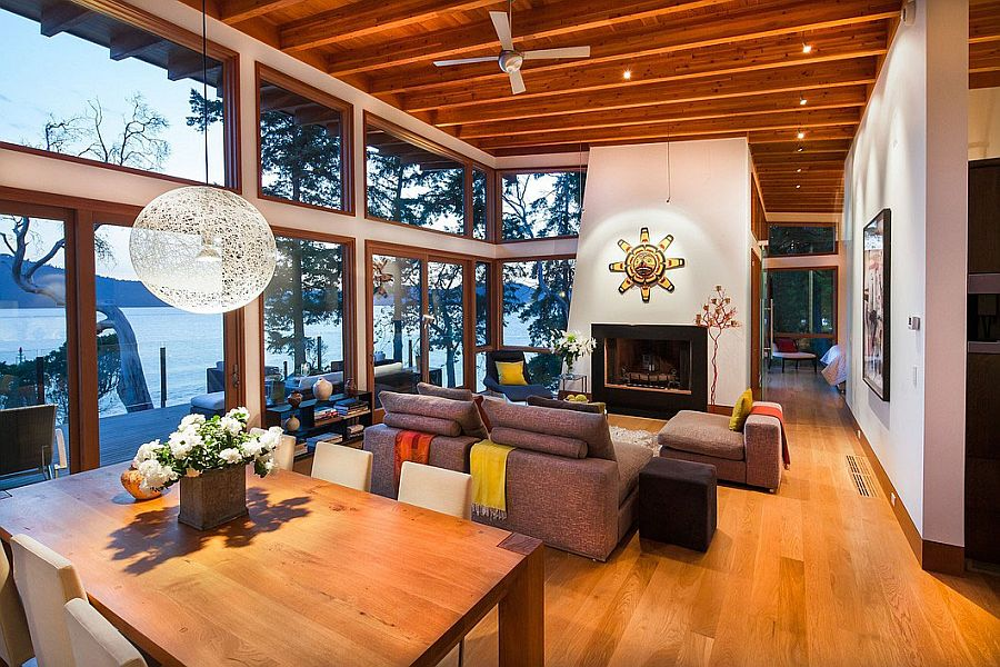 Large glass windows of the oceanside retreat offer unabated views