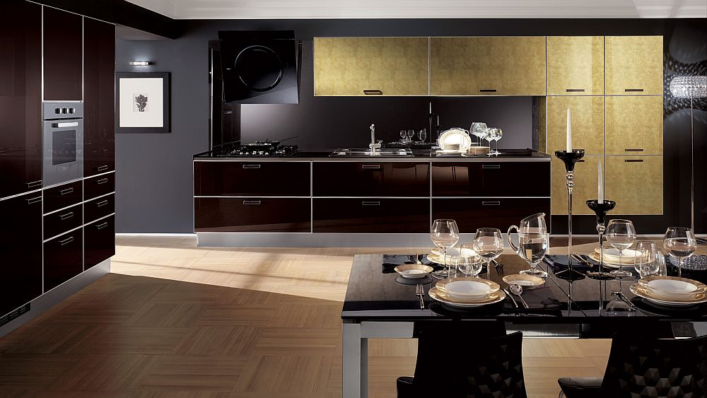 Leaf gold doors and glossy glass surfaces transform the mundane kitchen into a masterpiece