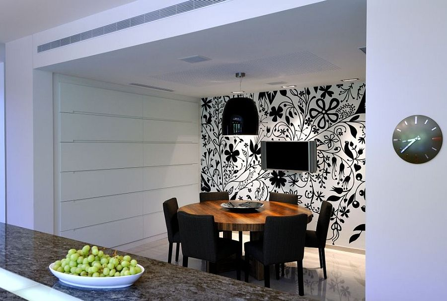 Lighting Adds To The Appeal Of Striking Black And White Wallpaper In Dining Room