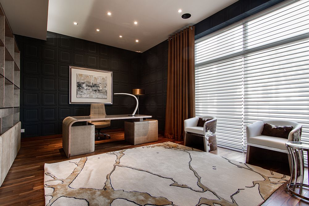 Lovely home office with dark walls and dark brown hues