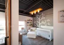 Lovely modern nursery design in gray with wall mural
