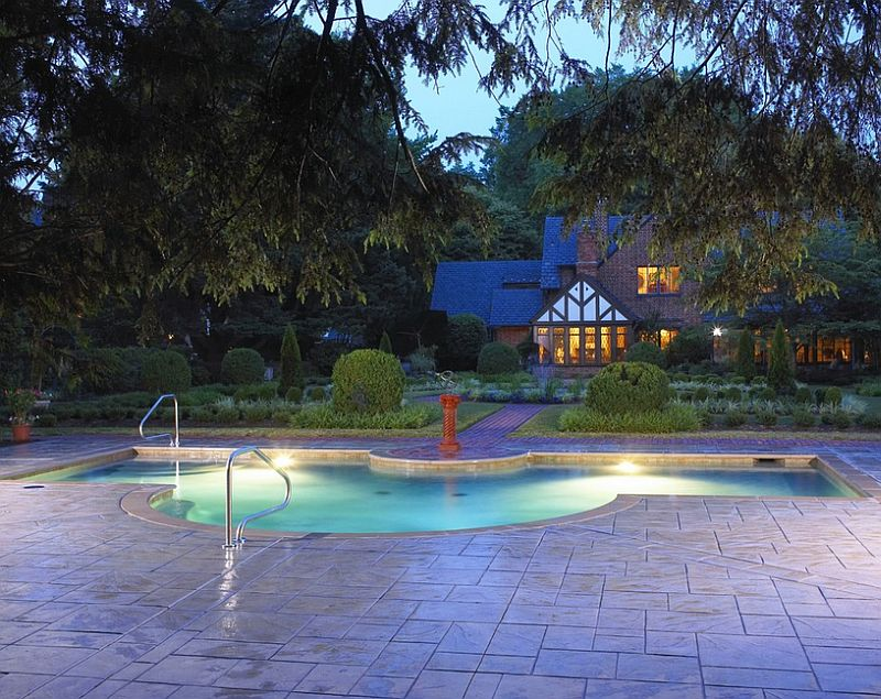Lovely modified rectangular pool with a stamped concrete deck [Design: Douglas Aquatics]