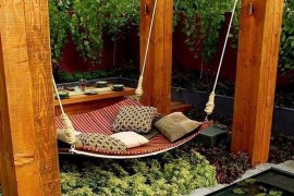 Lovely patio with a hammock that also doubles as a daybed!  Summer Spirit: 25 Cool Outdoor Hangouts with a Hammock! Lovely patio with a hammock that also doubles as a daybed 270x180