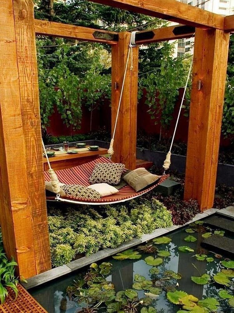 Lovely patio with a hammock that also doubles as a daybed!