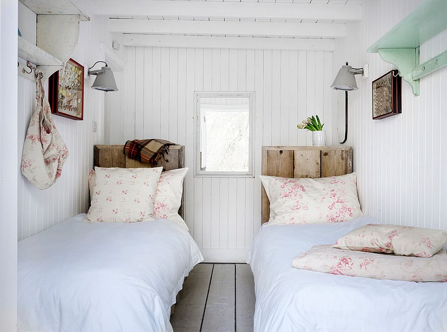 Lovely reclaimed headboards enhance the natural appeal of the serene bedroom [Design: Cabbages & Roses]