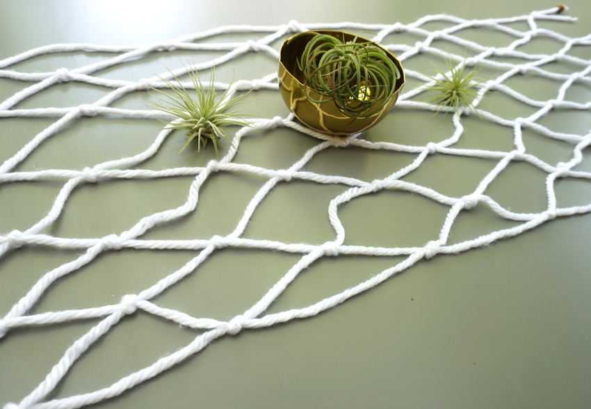 Macrame table runner with air plants