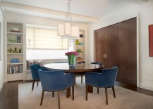 Mahogany sliding wall separates the kitchen and dining