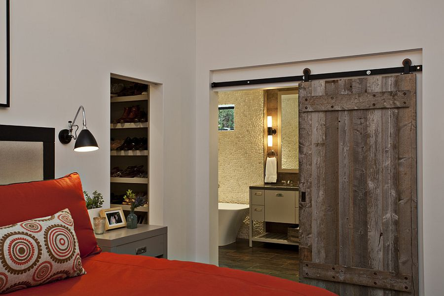 Master bedroom with barn door for the bathroom [Design: Fiorella Design]