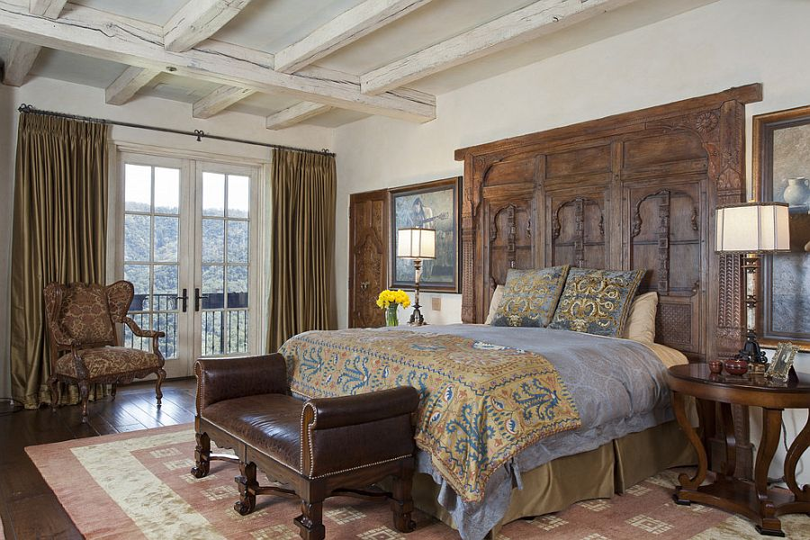 Mediterranean bedroom with a unique headboard crafted from antique Afghan window [Design: John Malick & Associates]