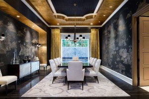 Mediterranean dining room in gold and black with modern vibe [Design: JAUREGUI Architect Builder]