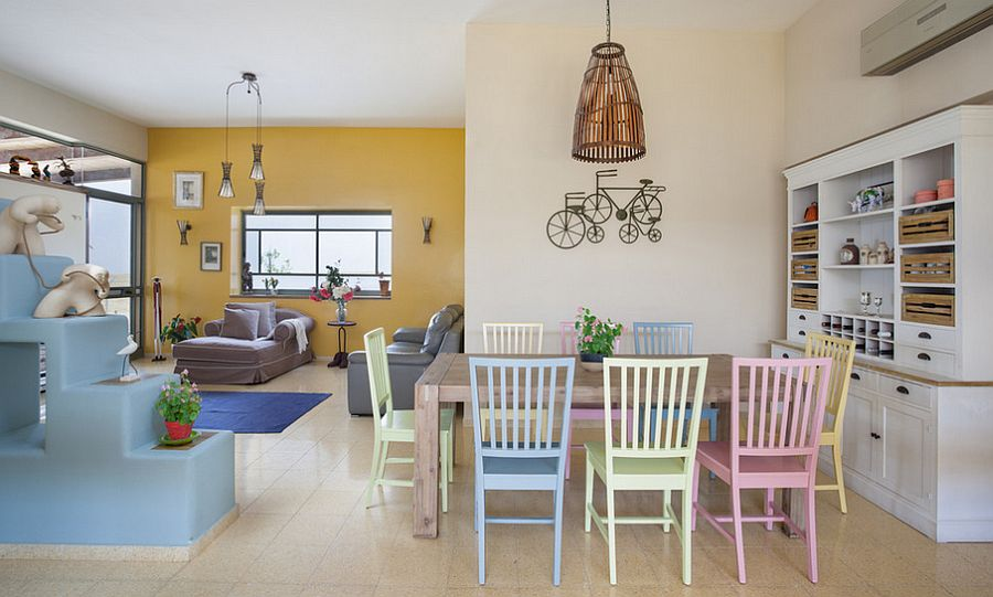 Mediterranean dining room with snazzy chairs in pastel hues [Design: Echo Design]