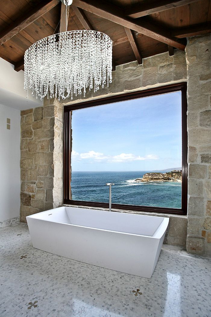 Mediterranean style bathroom with ocean view 25 Sparkling Ways of Adding a Chandelier to Your Dream Bathroom