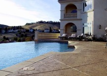Mediterranean-style-pool-area-with-stamped-concrete-deck-217x155