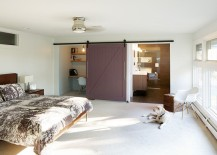 Midcentury bedroom with barn door for bathroom and office space