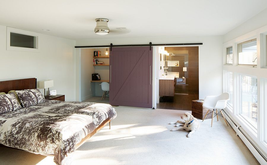 Midcentury bedroom with barn door for bathroom and office space [Design: Design Platform]
